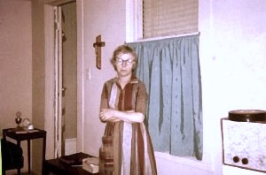 Mom visits my room. Note the window into the rest of the house, and the famous hi-fi.