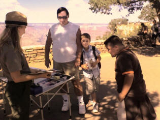 Michael helped Zach and Chris get special badges from the Grand Canyon ranger.