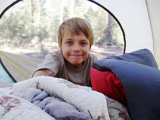 Nature Boy Zach in our tent at Bear Canyon Lake.